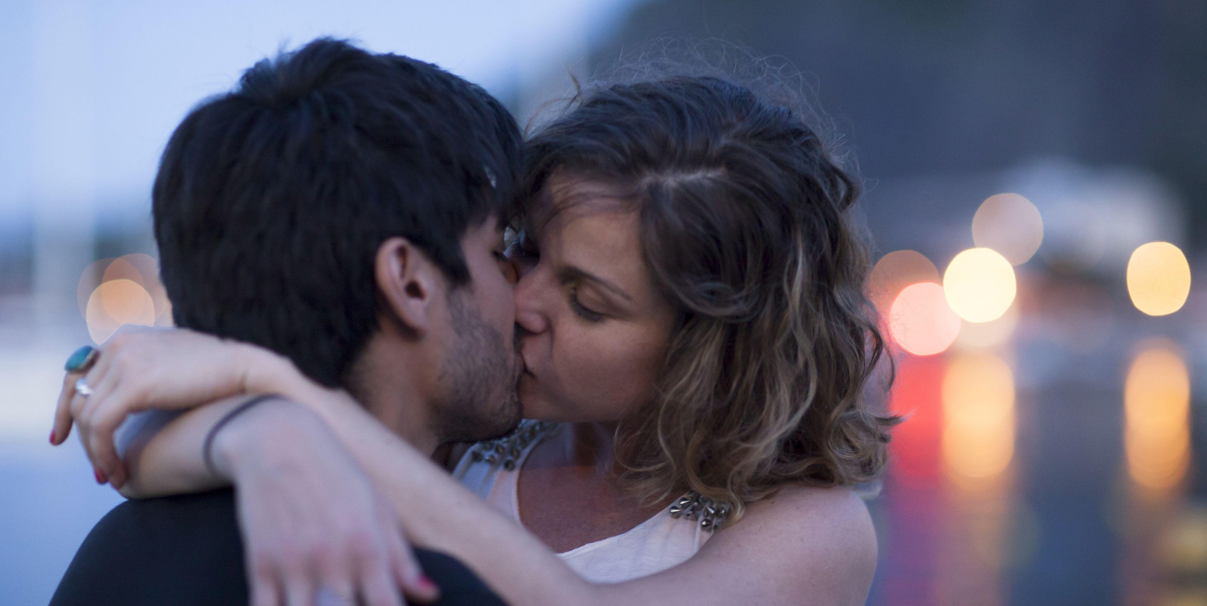 Young brazilian couple kiss at Dusk