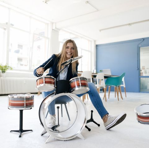 young businesswoman playing percussion
