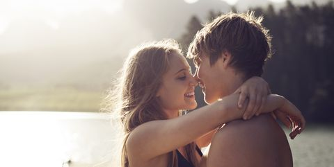 Young couple about to kiss in a natural environmen