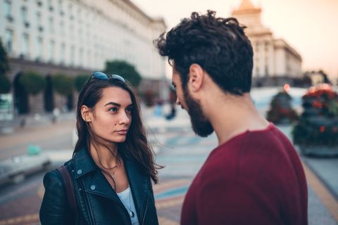 young couple arguing at the street