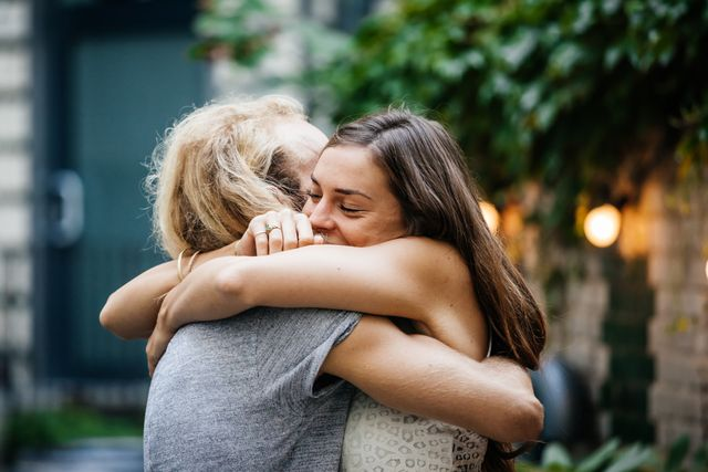 young couple embrace each other lovingly at barbecue meetup