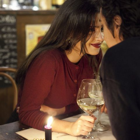 young couple having a romantic moment at a restaurant, rome, italy