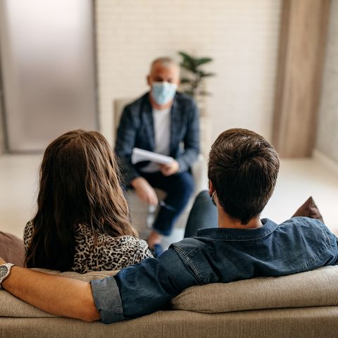 young couple on a therapy session with a psychologist