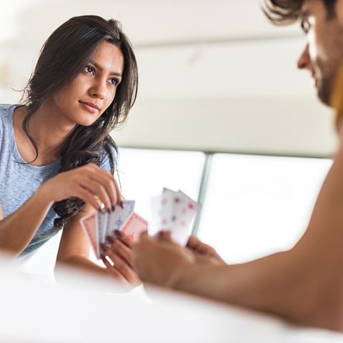 young couple playing cards at home