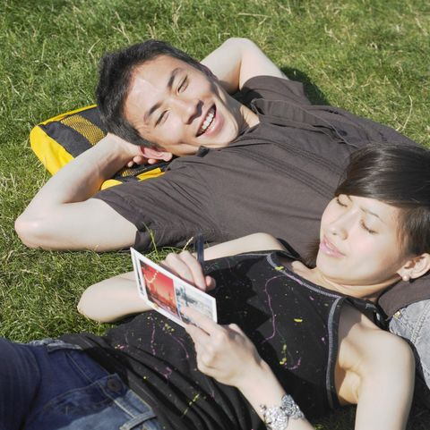 young couple relaxing in grass