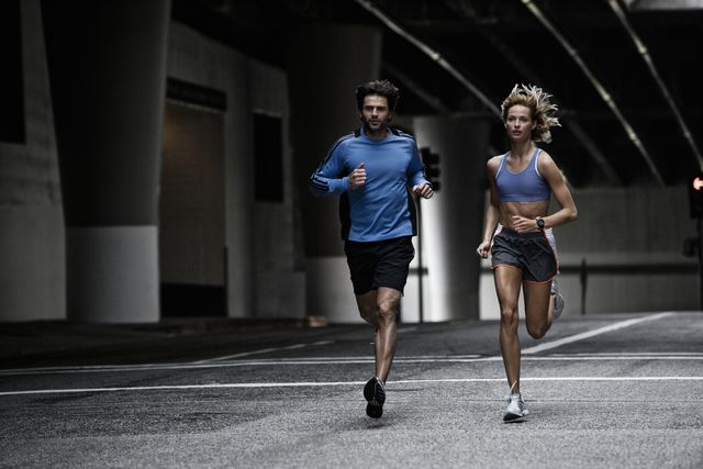 young couple running in the city