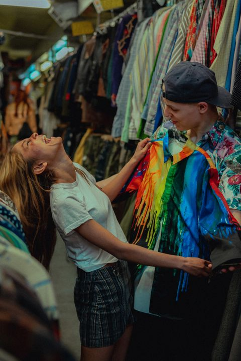 young couple shopping for clothes in a thrift store