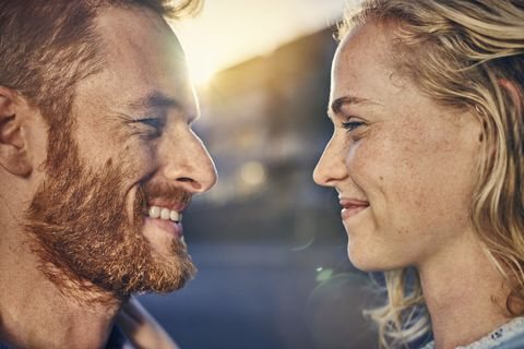 Young couple smiling at each other, close up