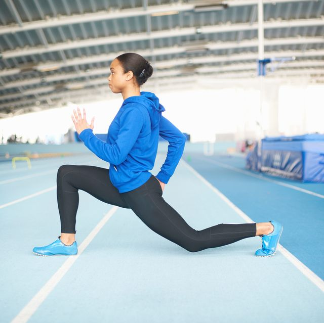 young female athlete lunging