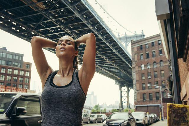 young female runner taking a break, new york, usa