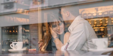 Young lovely couple resting in cafe