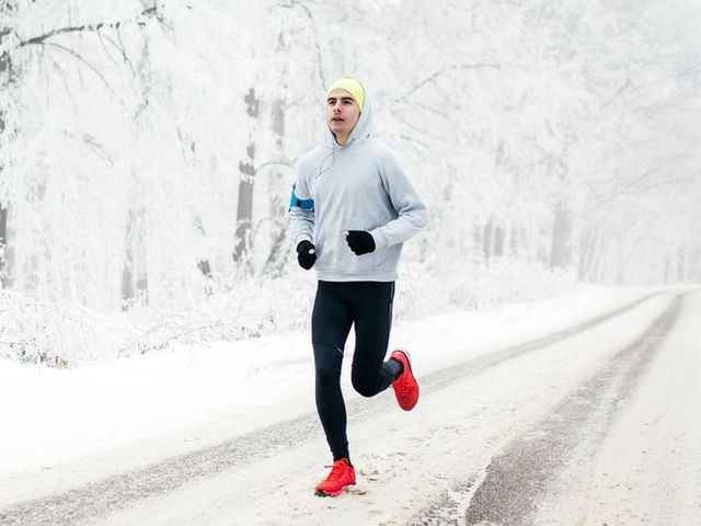 young male runner on the road