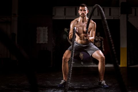 Young Man Doing Battle Rope Exercise