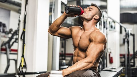 Young Man Drinking his Proteins at the Gym