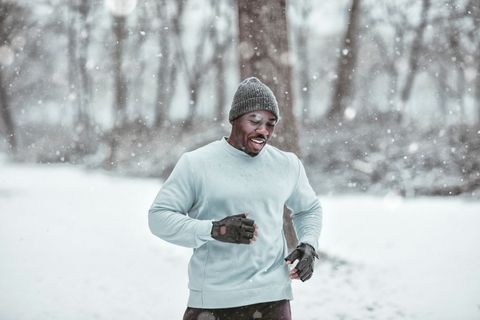 Young man exercising in the forest