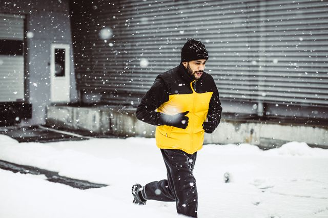 young man exercising in winter