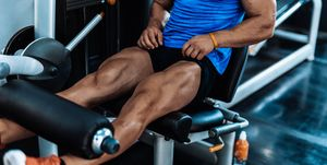 Young man exercising legs in the local gym
