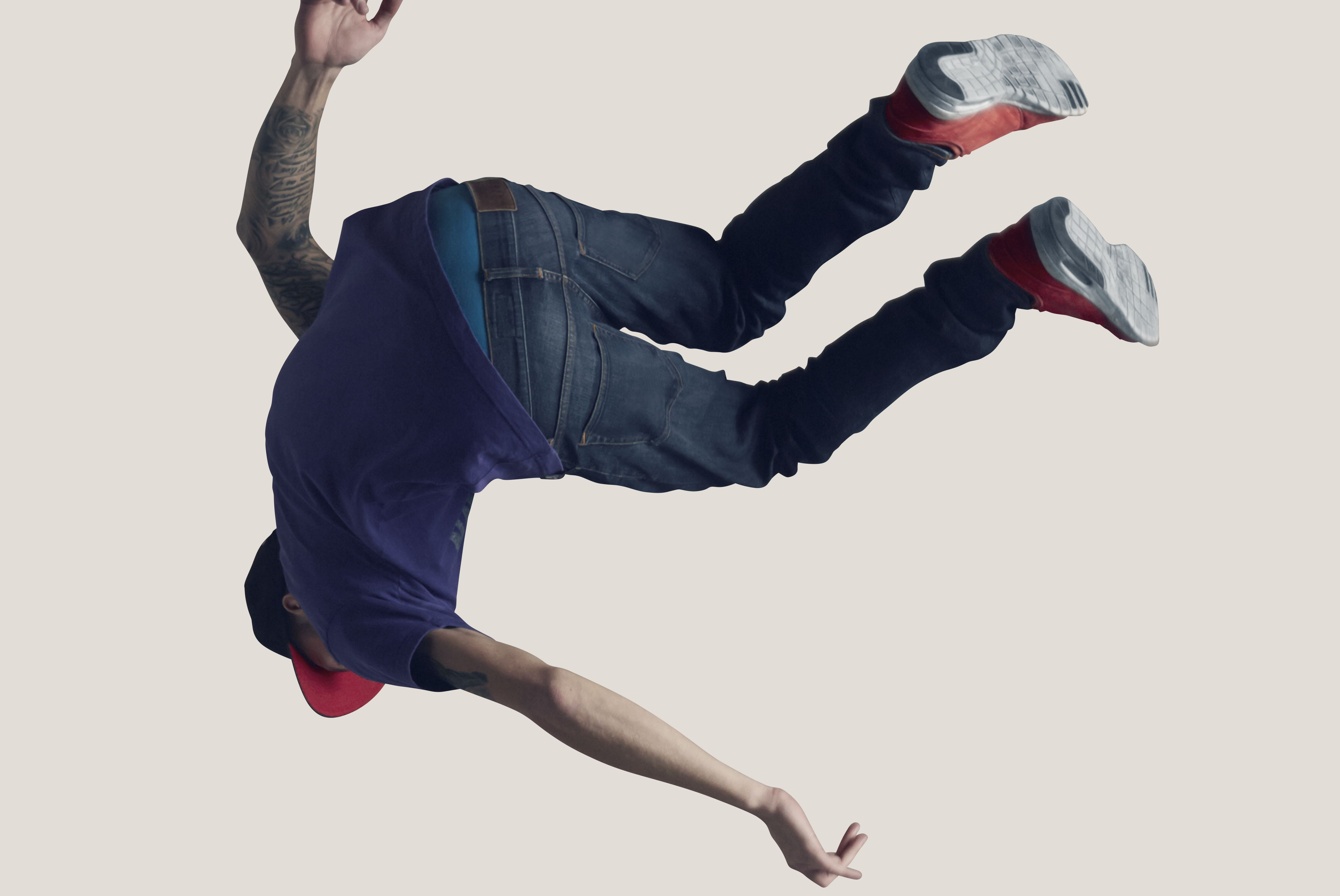 Young man hanging in the air, back to camera
