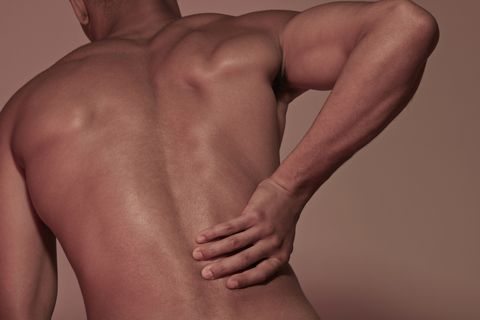 Young man having back pains