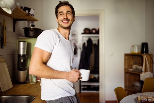 young man in kitchen with coffee