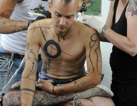 a young man is tattooed during the 13th