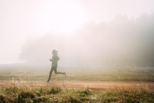 morning run  young man jogging on cold foggy morning