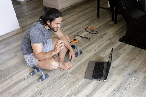 young man searches his training routine on youtube before starting to exercise at home