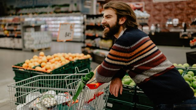 young man shopping in the supermarket