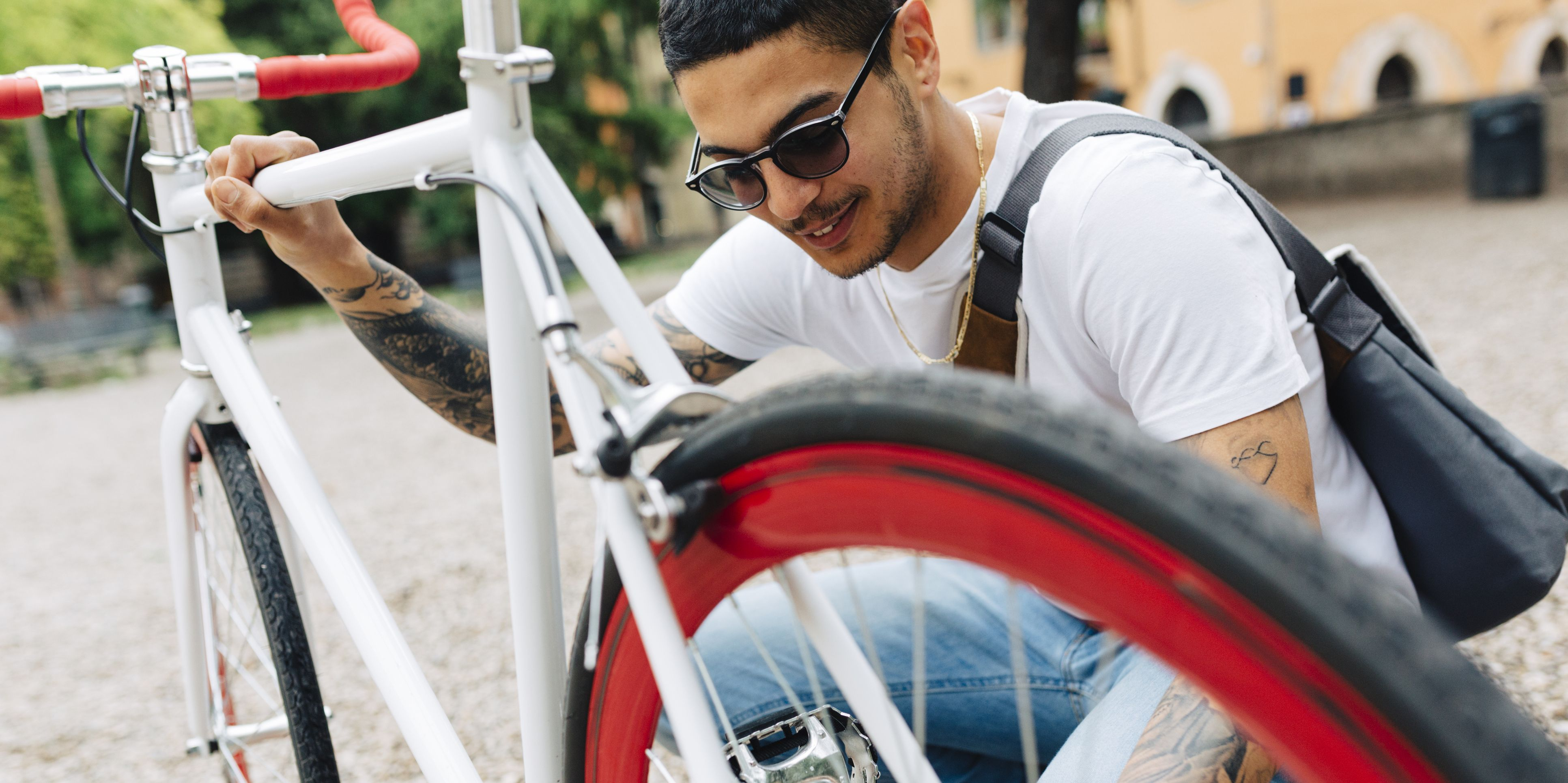 Young man with a bicycle outdoors