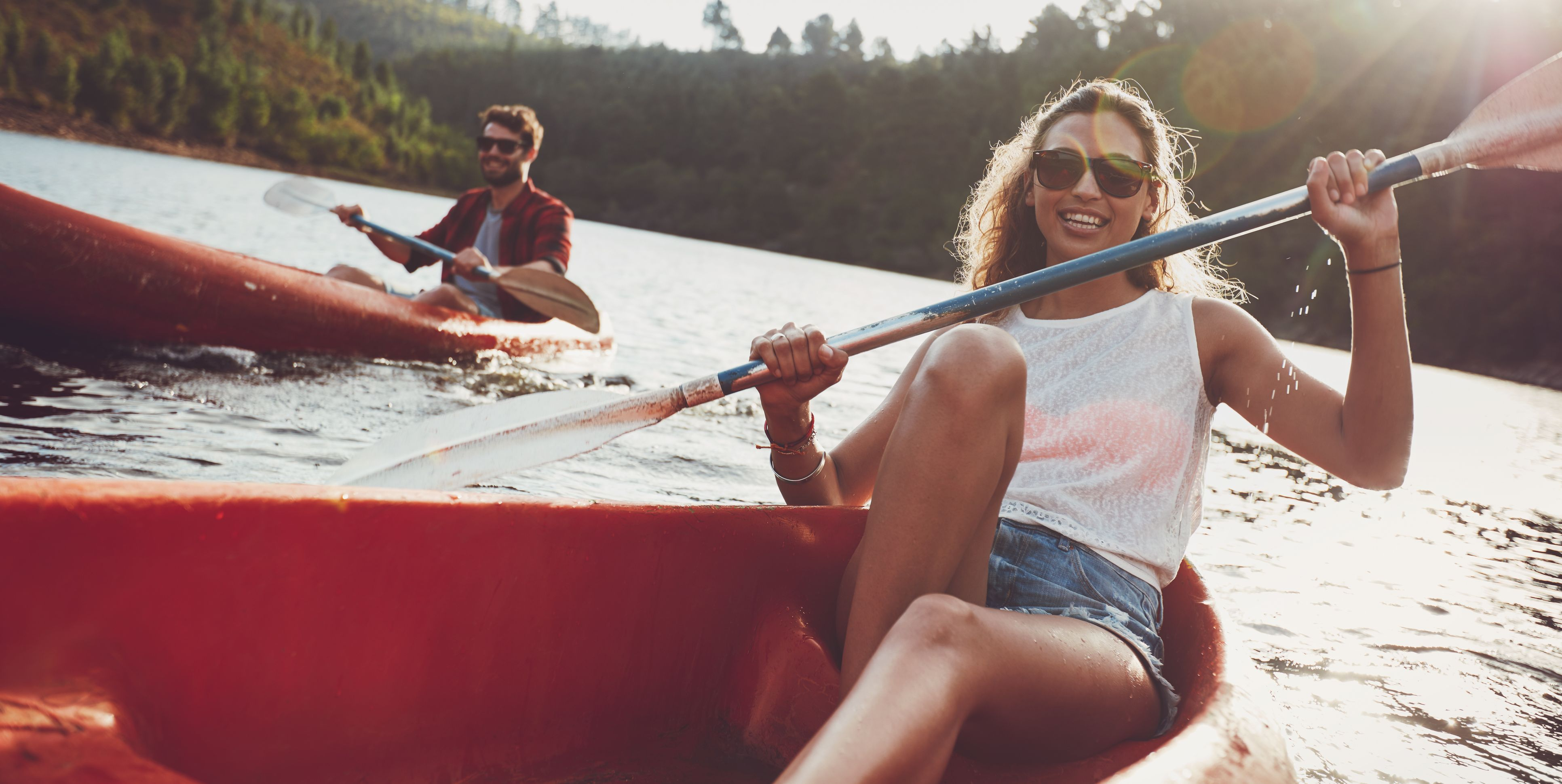 Young people canoeing in a lake
