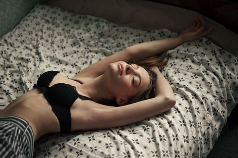 young sensual woman stretching in the morning