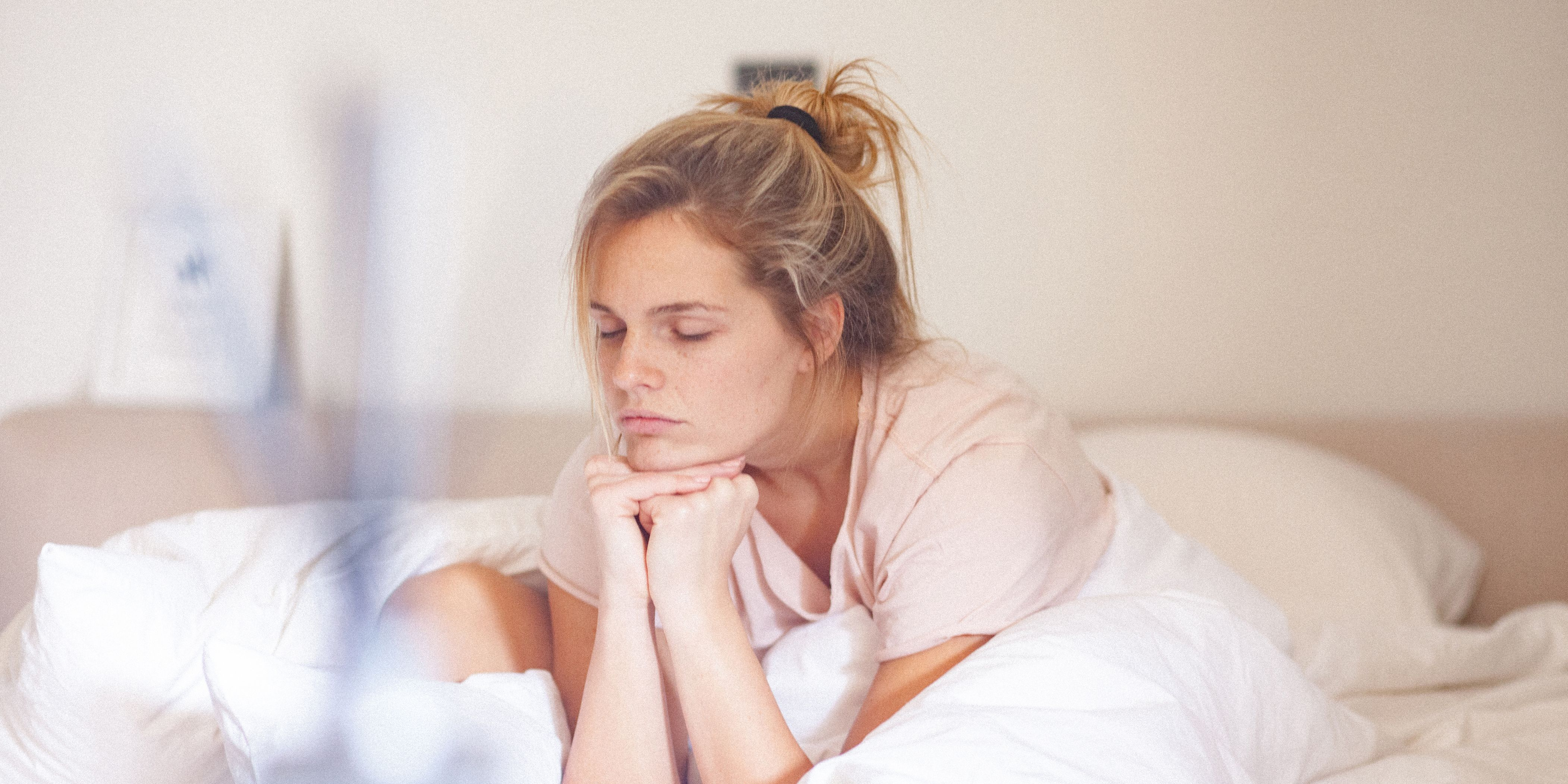 Young single woman in bed at home in the morning