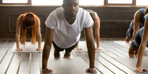 Young Sporty Black Man In Plank Pose
