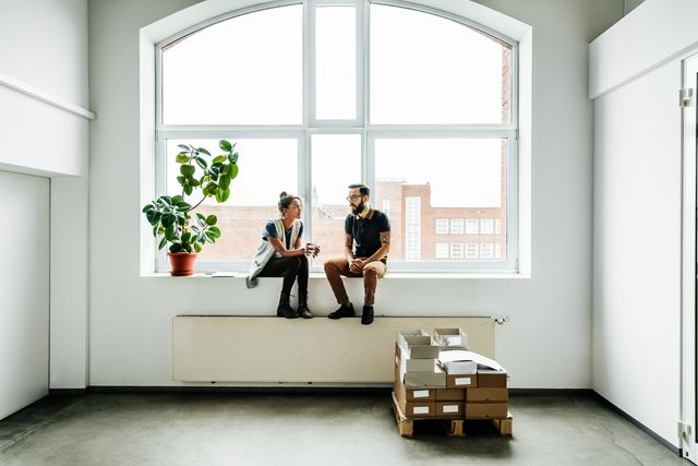 young start up business people sitting in a window and talking