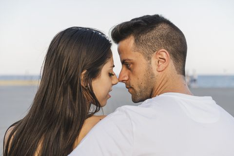 Young urban couple falling in love, kissing