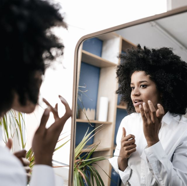 Young woman applying lip care