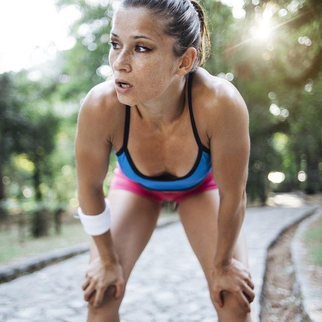 young woman athlete having a break
