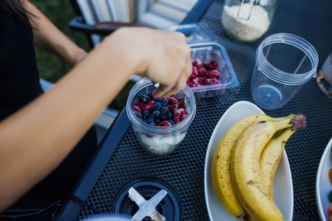 Young woman blogging and prepare healthy food
