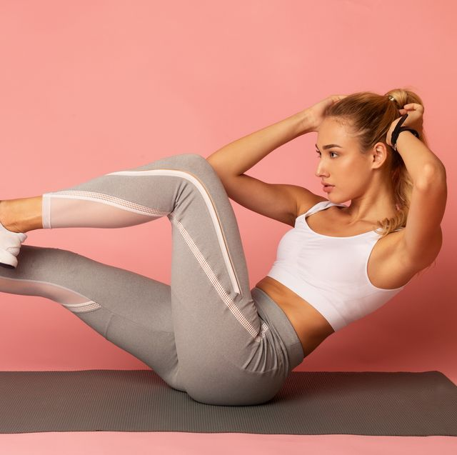 young woman doing bicycle crunch exercise, pink background, panorama