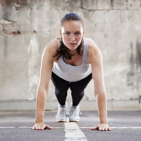 young woman doing burpee exercise
