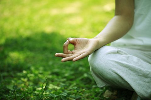 young woman doing yoga,hand close up