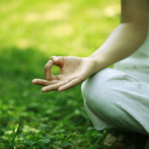 young woman doing yoga hand close up