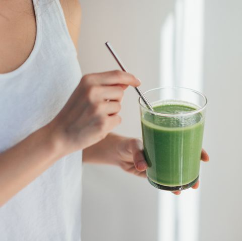 young woman drinking green juice for cleanse diet