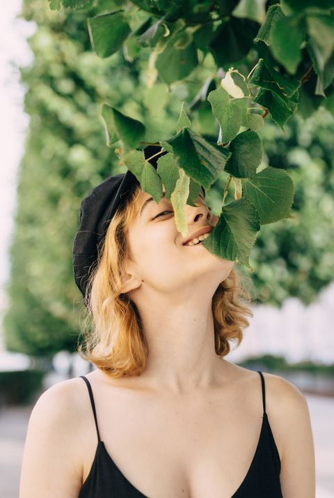 Young woman eating leaves