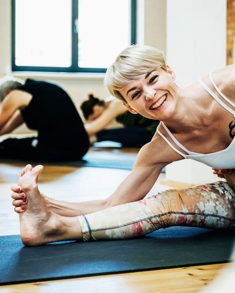 Young Woman Enjoying Yoga Class