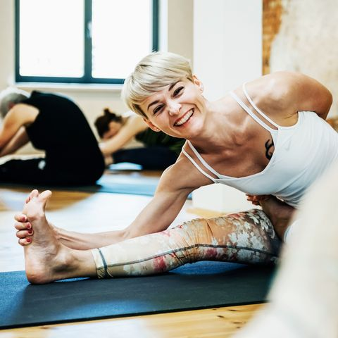 Young Woman Enjoying Yoga Class