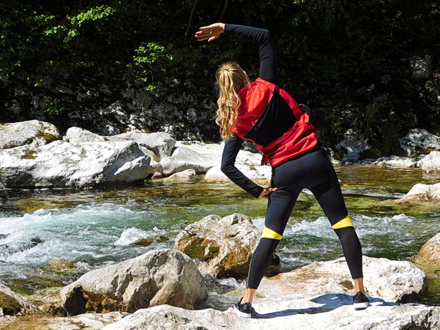 young woman exercising and stretching before jogging