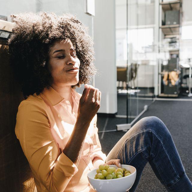 young woman having a break in office