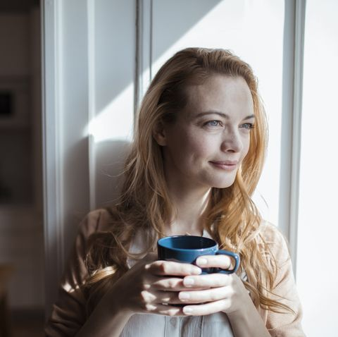 young woman having a cup of coffee