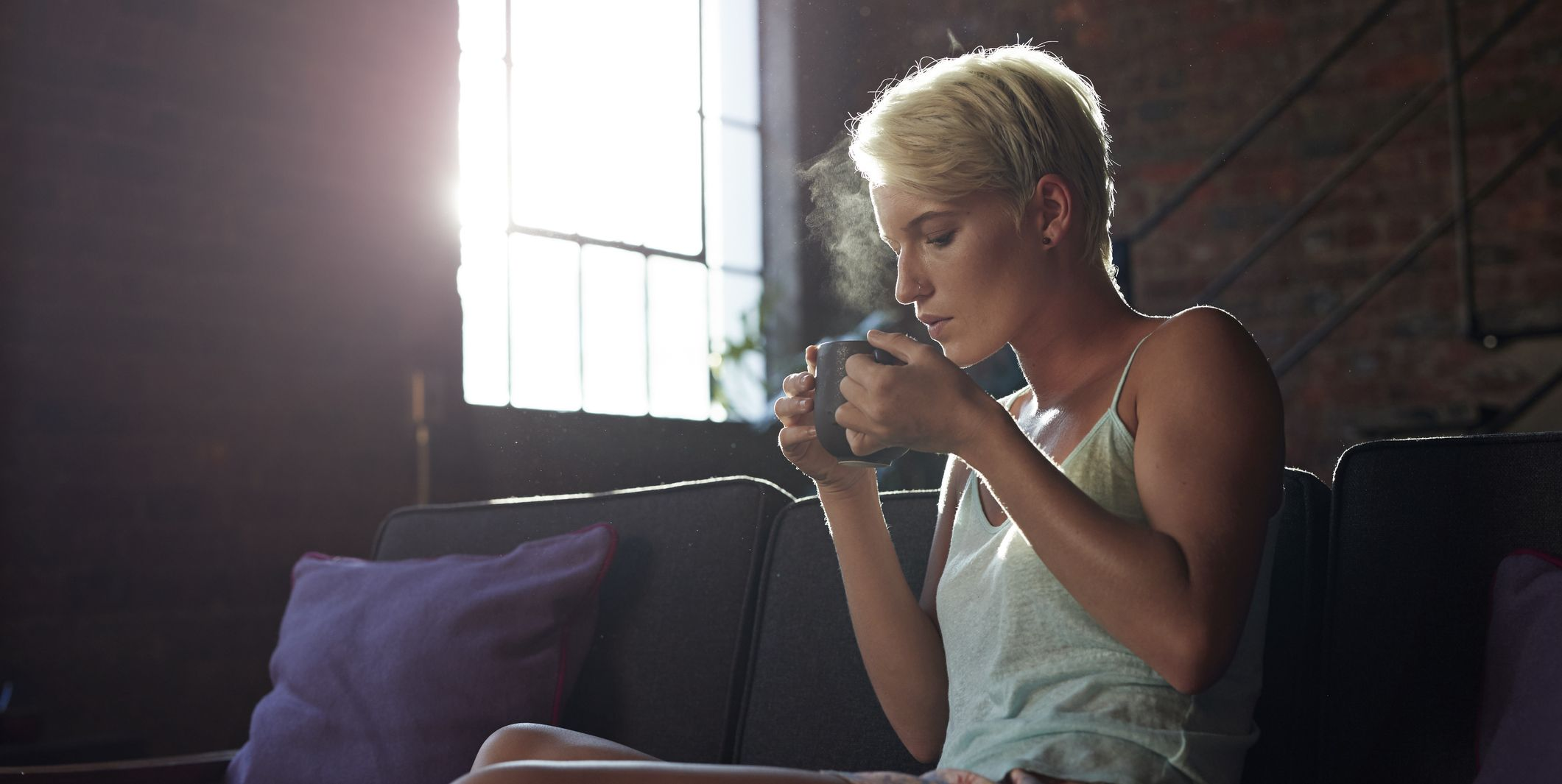 Young woman having a cup of tea